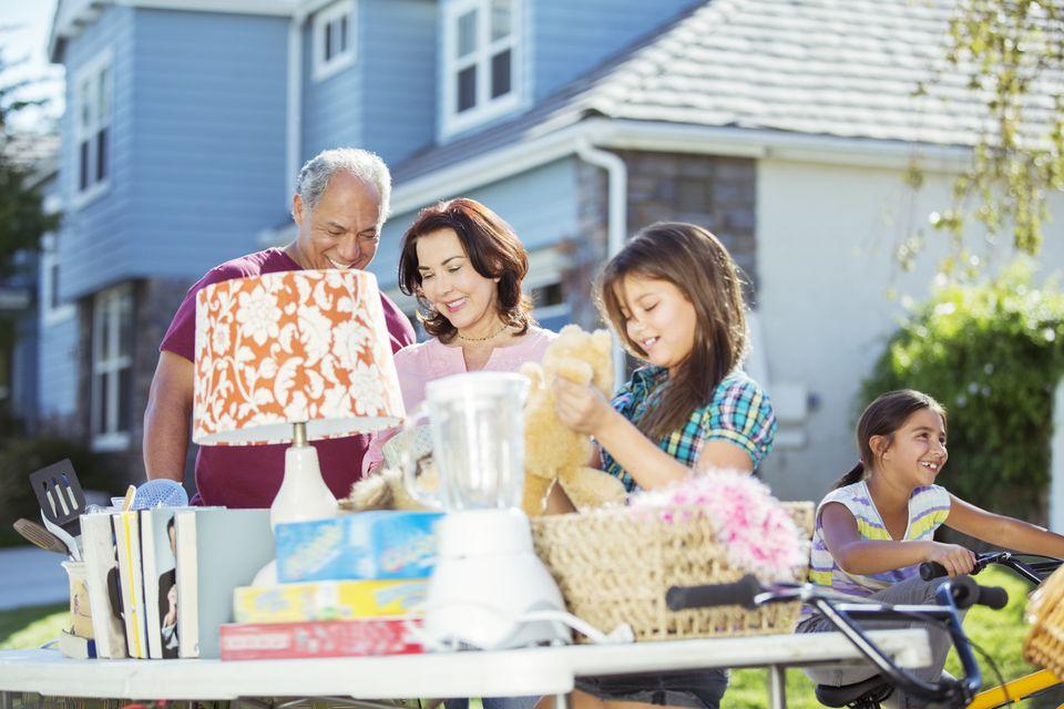 family shopping at yard sale