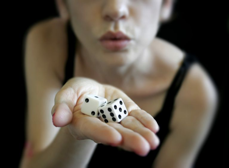 Woman rolling dice