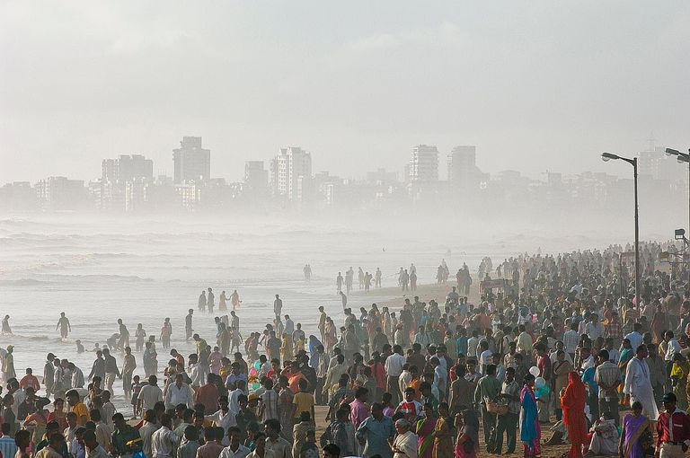 Mumbai locals crowd the waterfront at Juhu Beach to welcome the first rains of the monsoon, Mumbai, Maharashtra, India