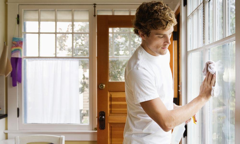 Man Washing House Windows
