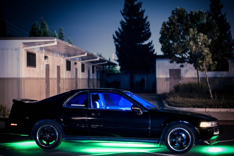A car with blue underglow ground effects lighting