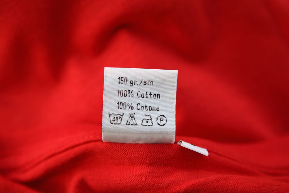 Washing label on Red cloth, close-up