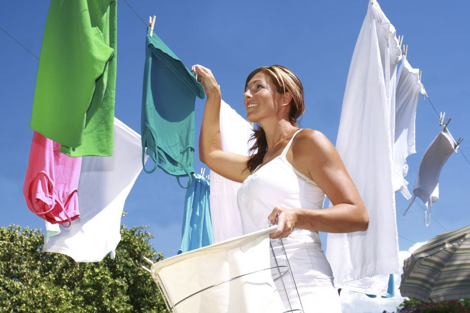 Hanging clothes on clothesline