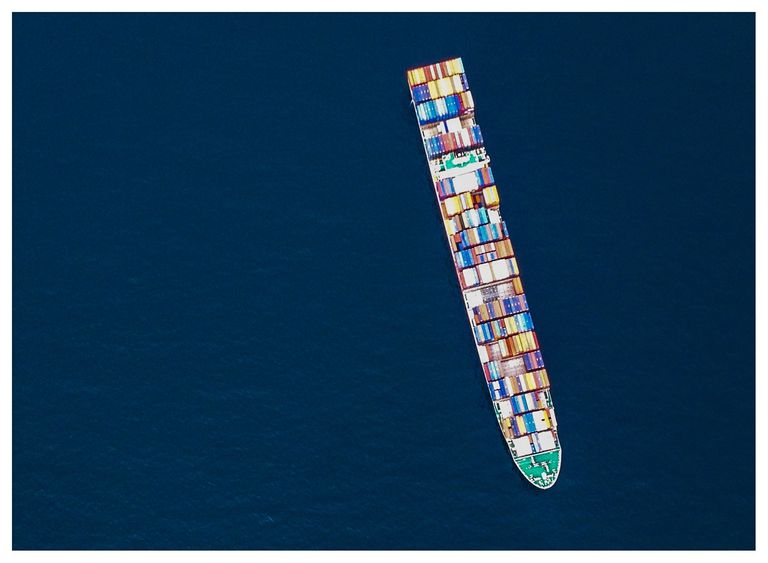 Directly Above View Of Cargo Ship On Sea