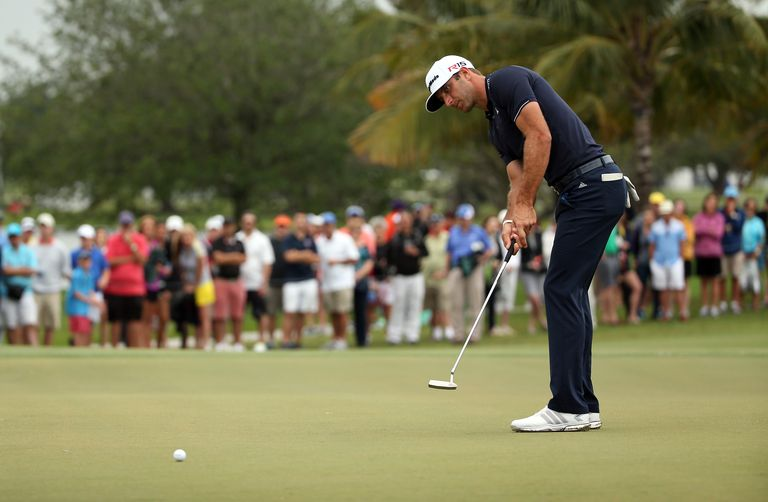 Dustin Johnson putts during his victory at the 2015 WGC Cadillac Championship