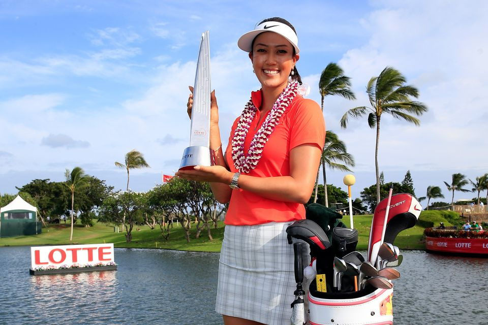 Michelle Wie poses with the trophy after winning the LPGA LOTTE Championship Presented by J Golf