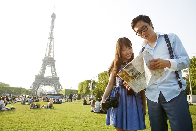 Young couple at the Eiffel Tower