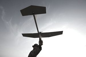 ilhouette of a U.S. Marine Preparing to Launch an Unmanned Aerial Vehicle (UAV) in Afghanistan's Helmand Province