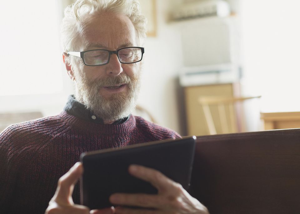 Senior man with eyeglasses using digital tablet