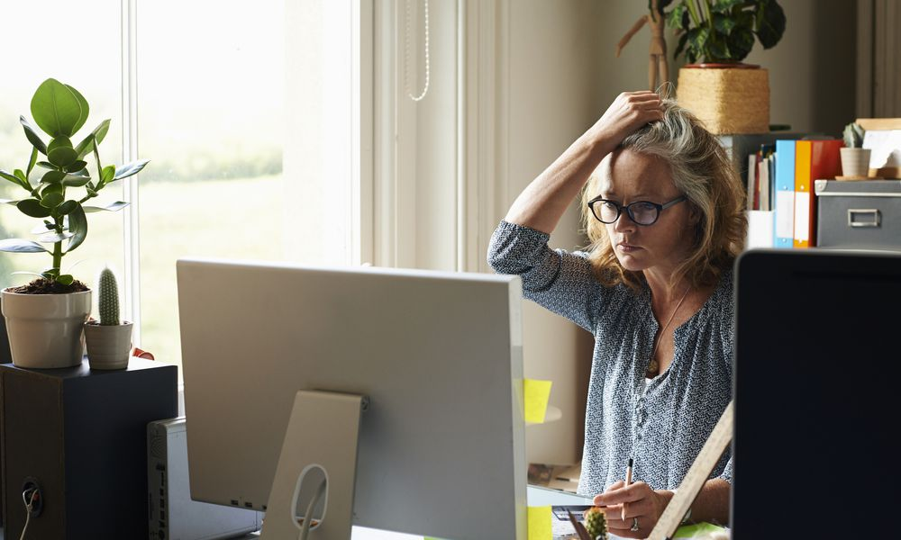 Stressed woman sitting at her desk