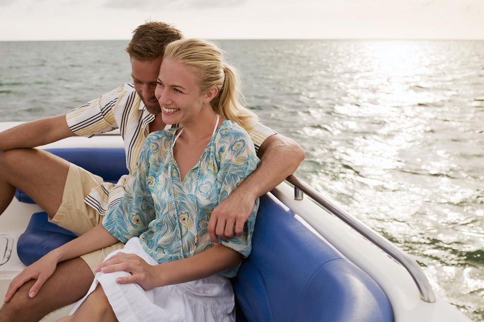 Portrait of couple in the back of a boat