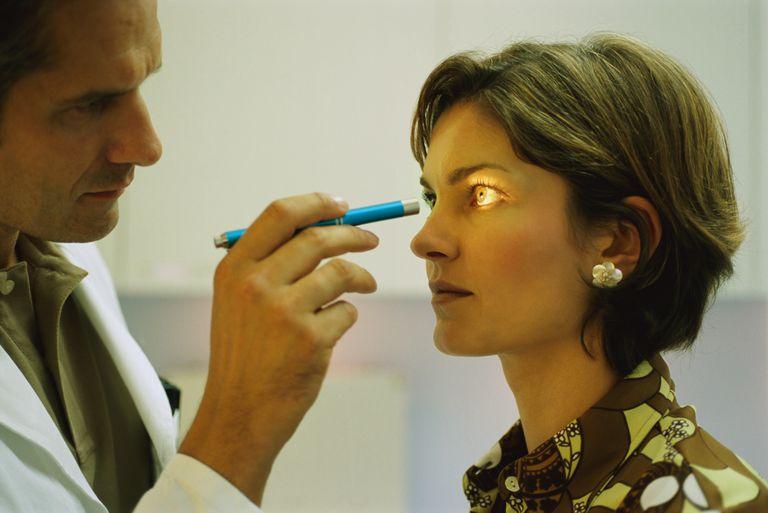 Doctor testing eye muscles