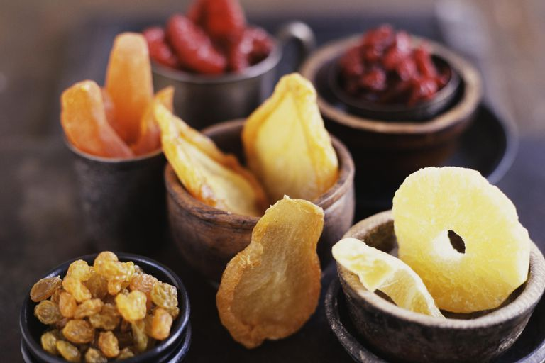 Dried fruit takes up less space so it has more sugar per total volume (not piece) of fruit.