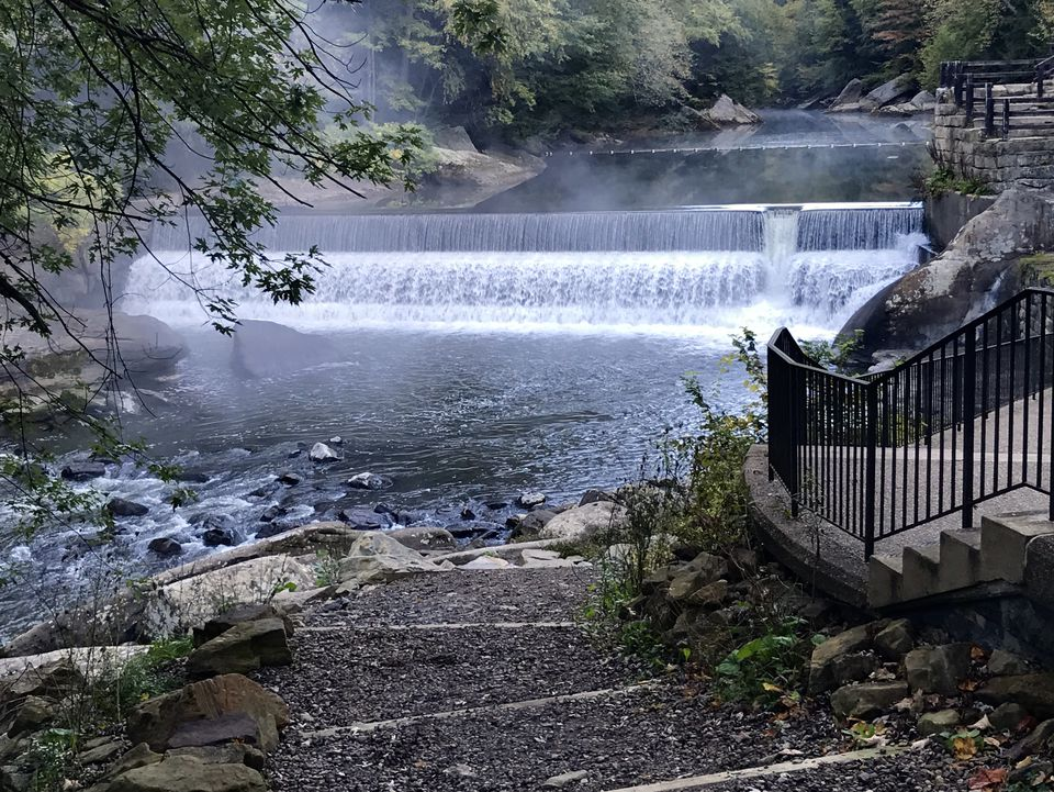 The waterfall and steps at the side of the grist mill at McConnell's Mill State Park in Western Pennsylvania is seen with mist rising from the water
