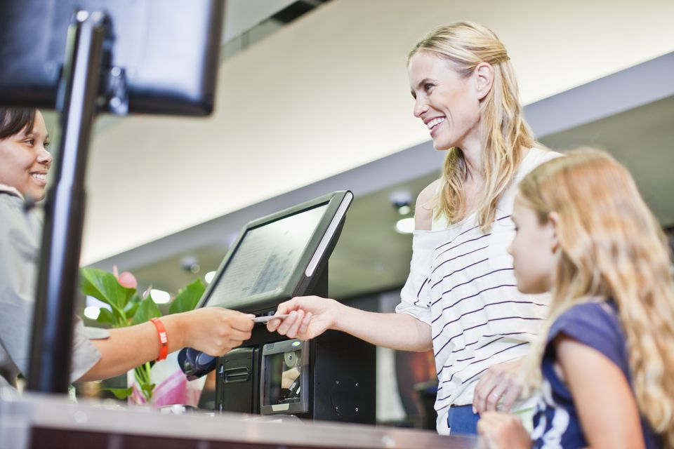 Mother receiving gift card at store