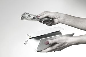 Woman's hand paying with cash