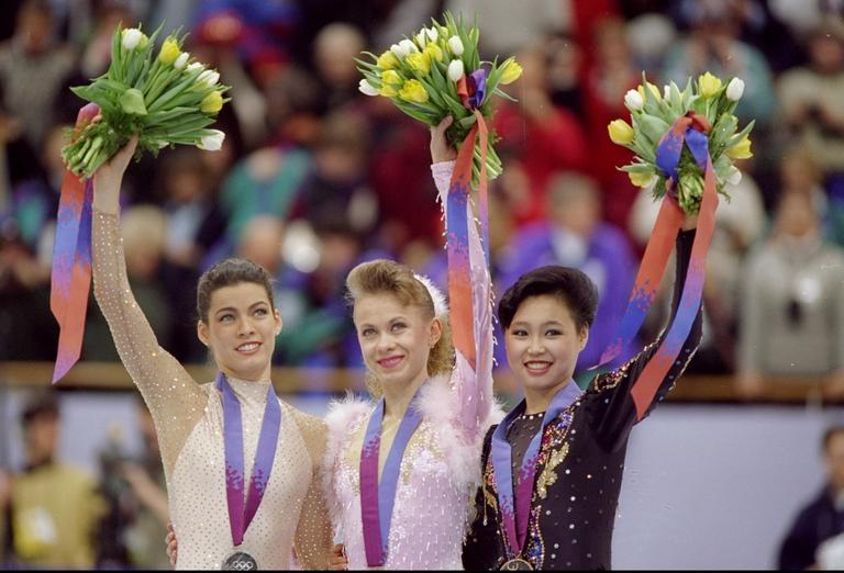 Nancy Kerrigan - Oksana Baiul - Lu Chen - 1994 Lillehammer Winter Olympics medal ceremonyKerrigan-Bauil-Lu-Chen-245889.png