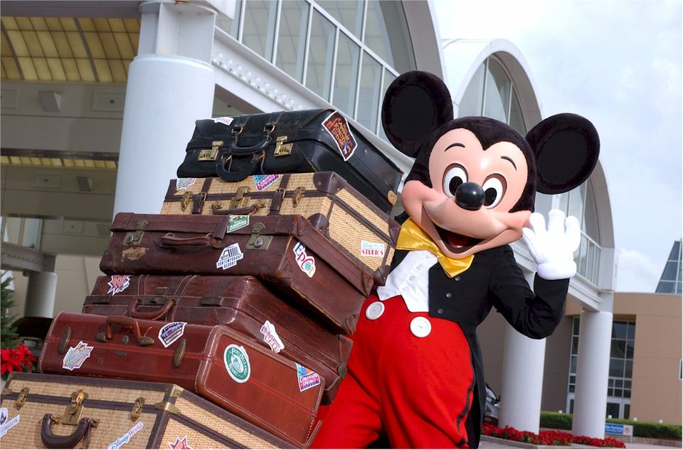 Mickey Mouse welcomes vacationing guests to Walt Disney World Resort
