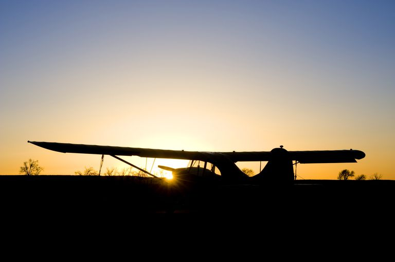 Sunset and airplane silhouette