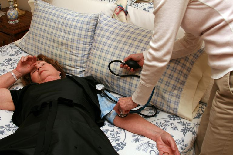 Mature Woman is having Blood Pressure Check