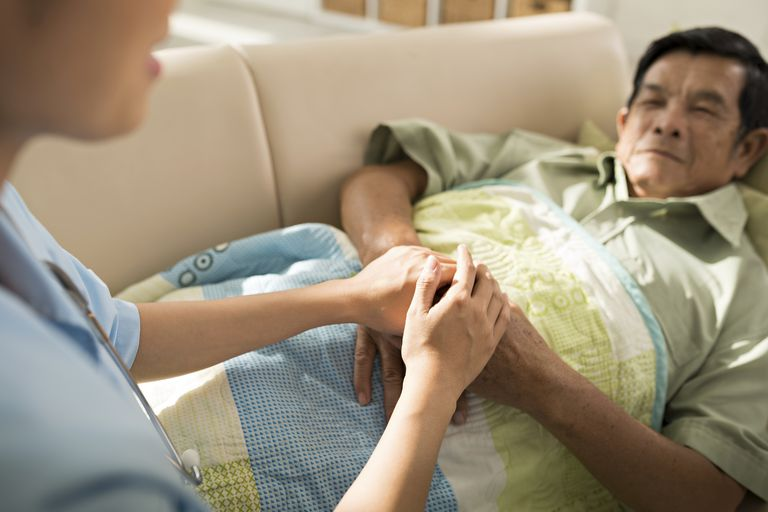 woman touching a cancer patient's hands
