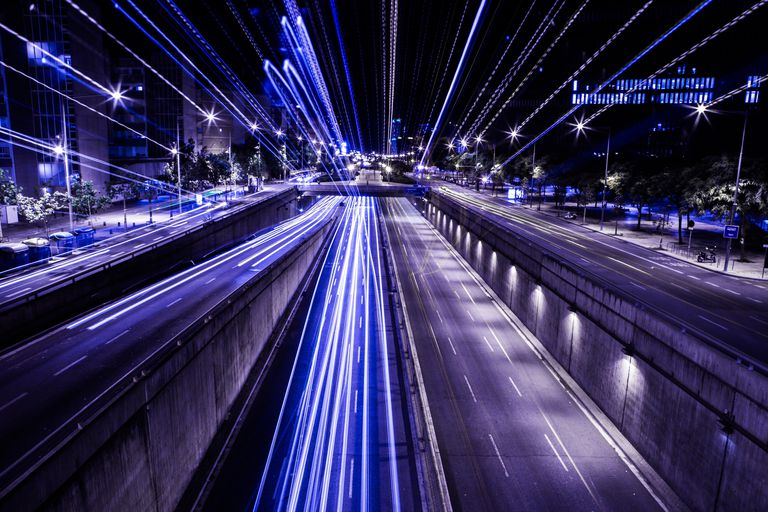 Lights on a highway. The speed of light, which is how fast light travels in a vacuum, is an important physical constant you should know.