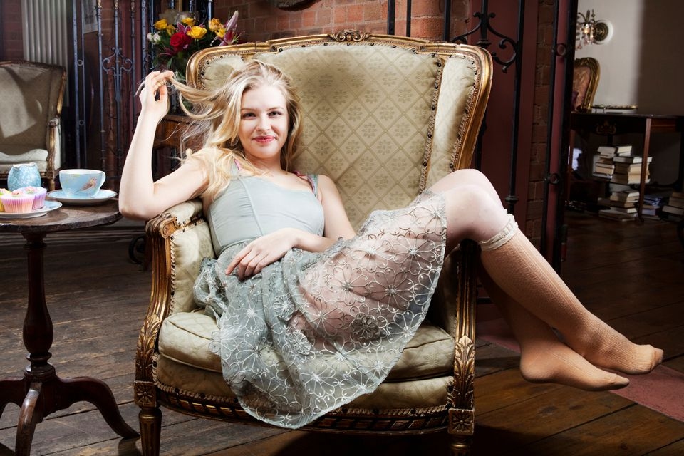 woman lounging in vintage chair