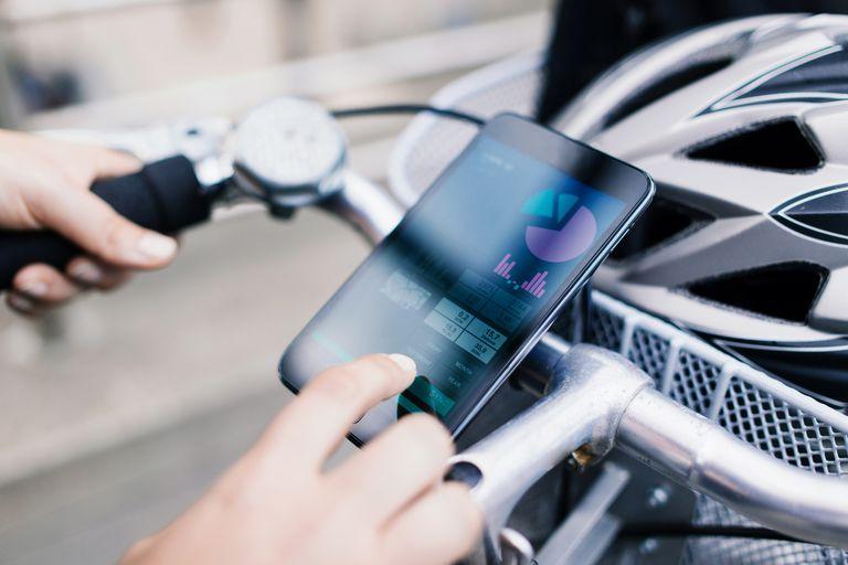 Woman using app on bike