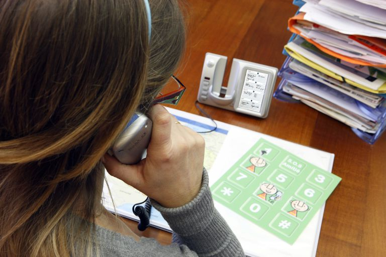 Woman calling SOS (Telephone counseling)