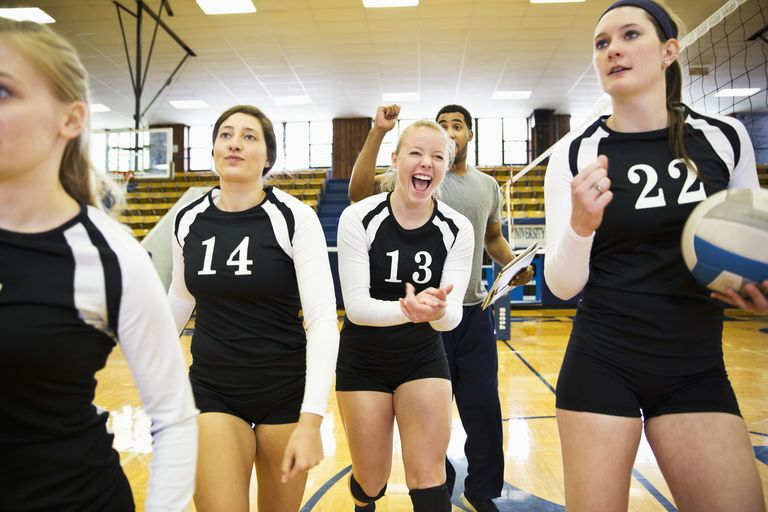 Female volleyball players excited at the gym