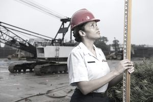 A U.S. Air Force engineer surveys a site currently under construction.