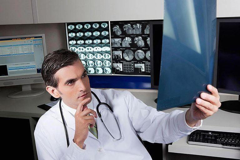 (Neurologist) Doctor examining an x-ray report