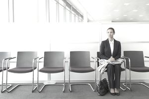 Businesswoman sitting in waiting area