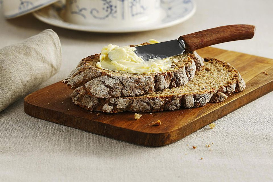 Slice of buttermilk bread, spread with butter