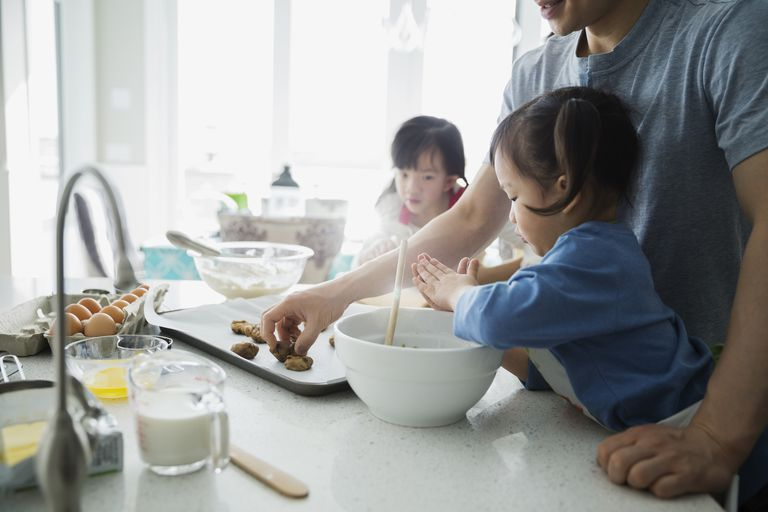 Family baking cookies in kitchen