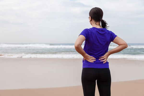 Woman holding back in pain
