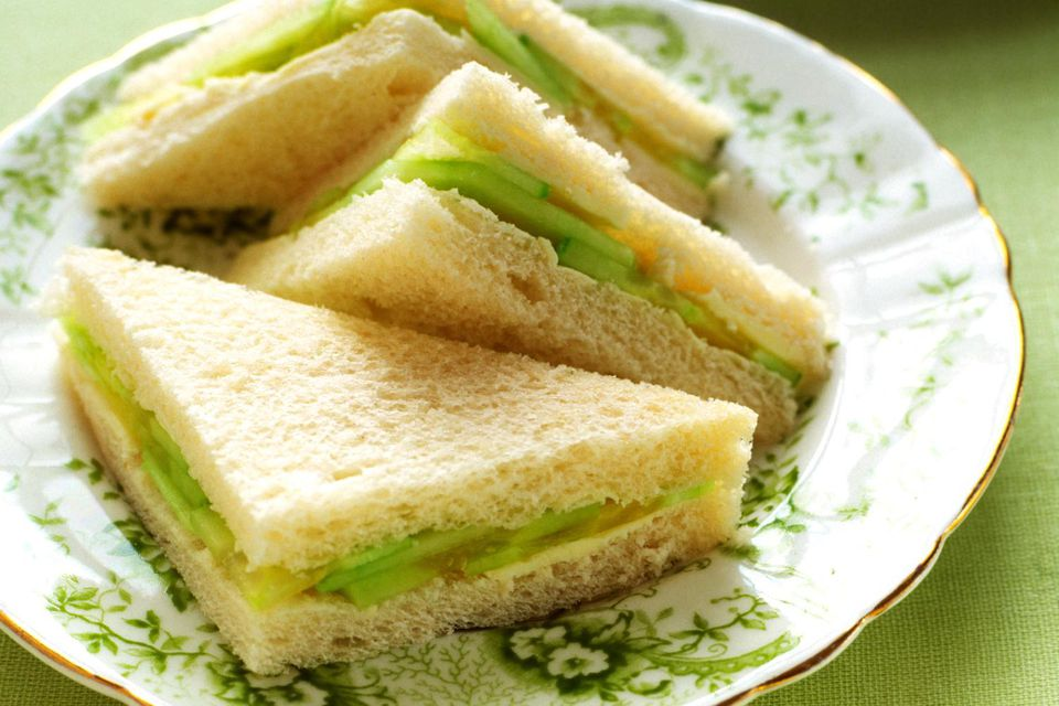 Cucumber sandwiches on plate with tea