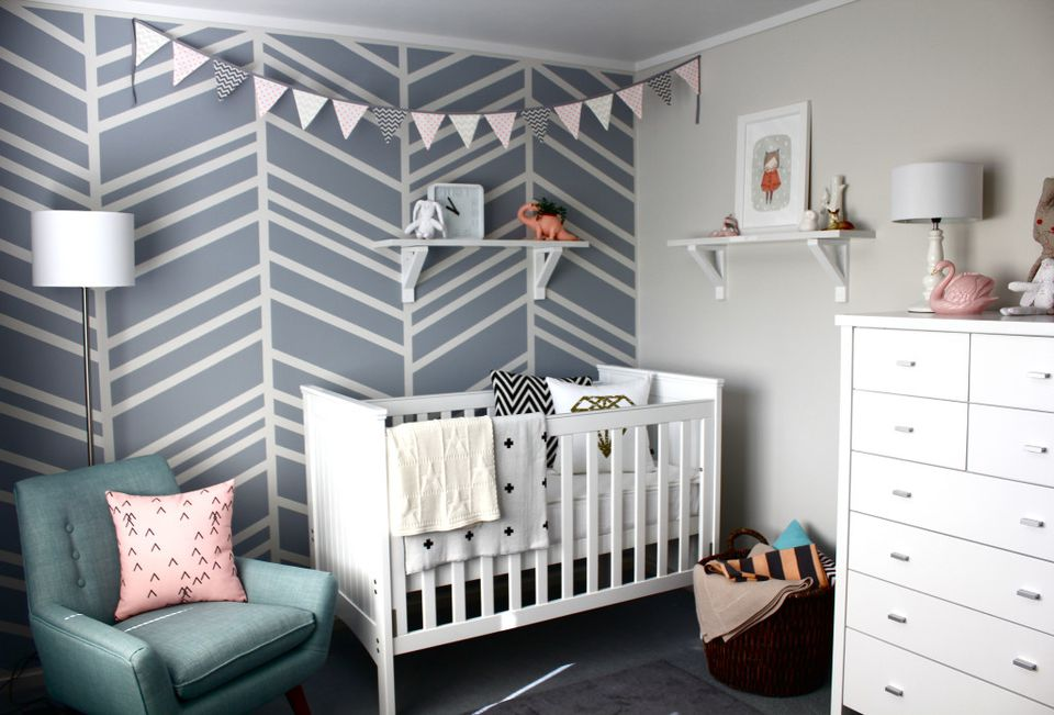 Grey and white nursery with bold, herringbone accent wall
