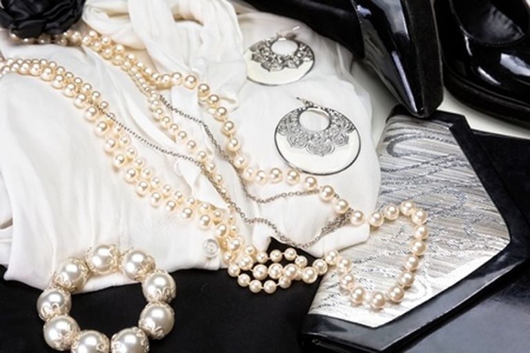 Business accesories including earrings, necklace, clutch purse and shoes