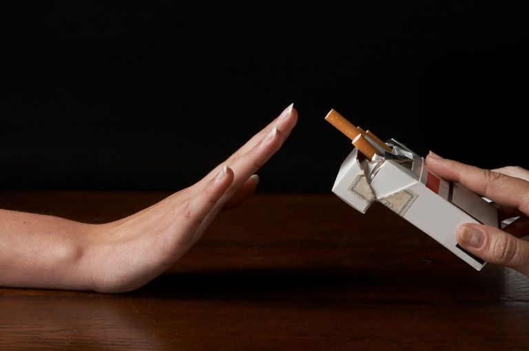 hand refusing a cigarette in a package