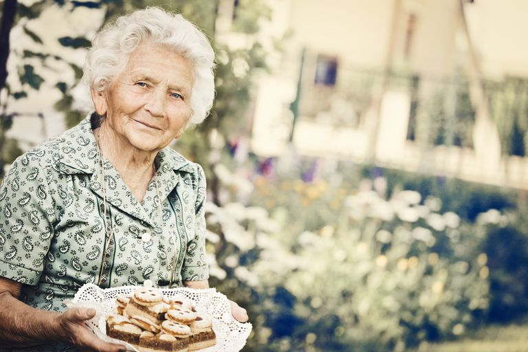 elderly woman with a plate of cookies