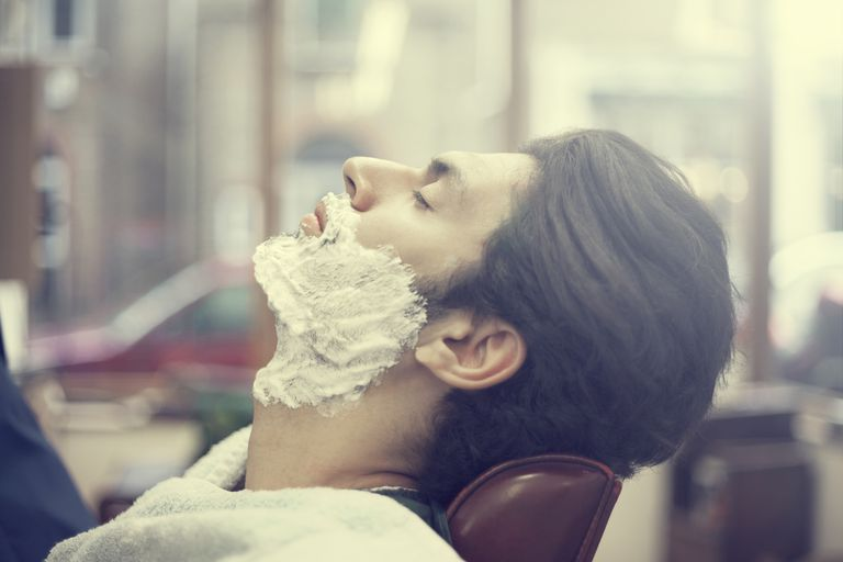 Man having traditional wet shave in barbershop