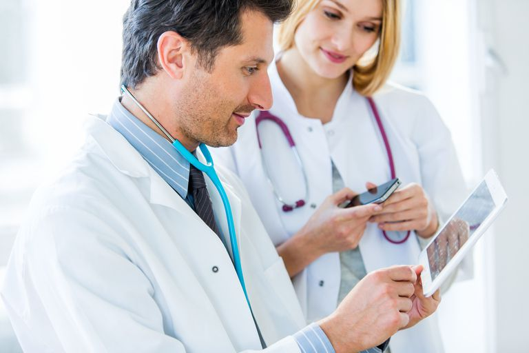 doctors using app on tablet and smartphone