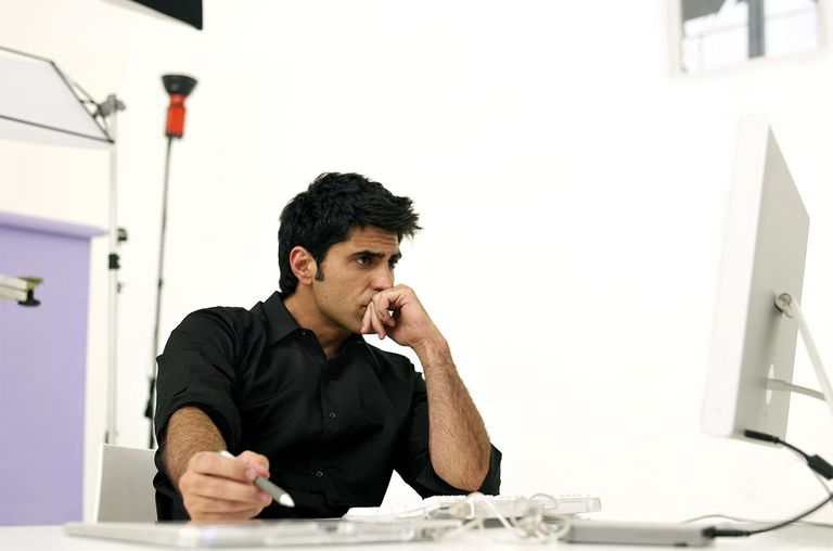 Photographer using computer in studio