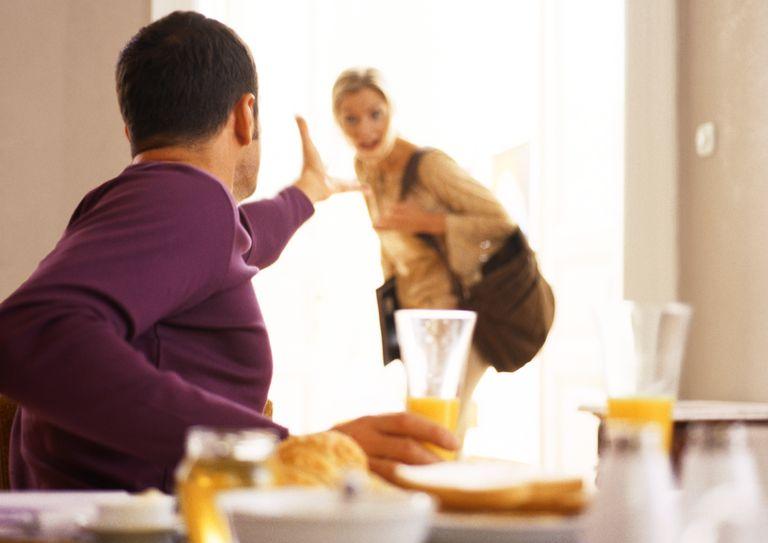 Man gesturing to woman leaving.