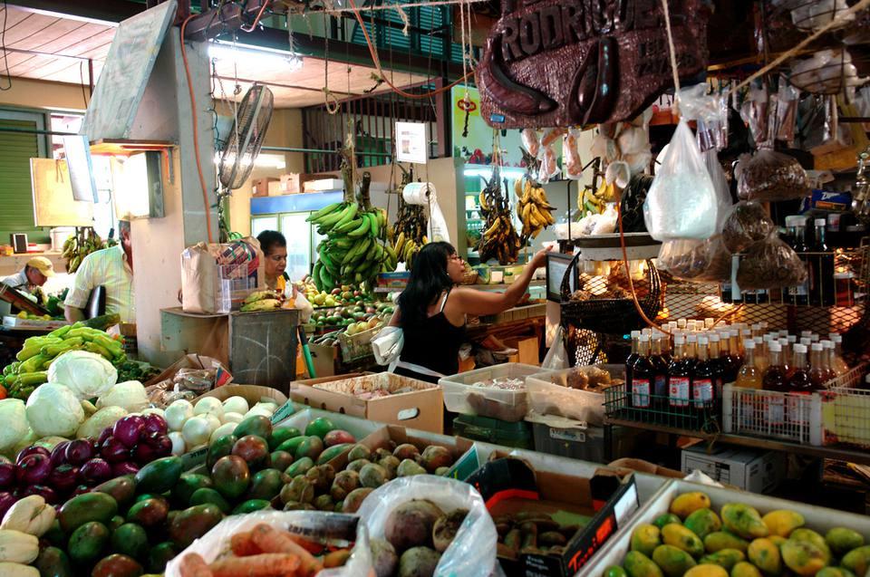 a fruit vendor at the Plaza del Mercado in Santurce, San Juan