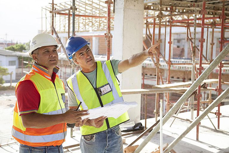 Builder meeting on a large construction site of a new school
