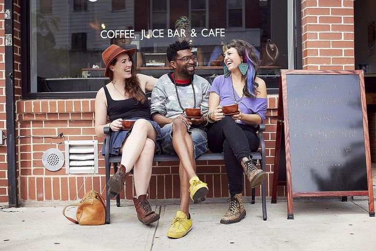 A Black man talking and laughing with two white women represents how race affects social interaction. Learn how symbolic interaction theory can help you make sense of how race and gender shape interaction.