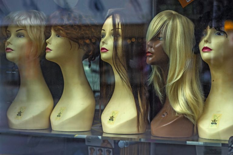 Wigs in store window