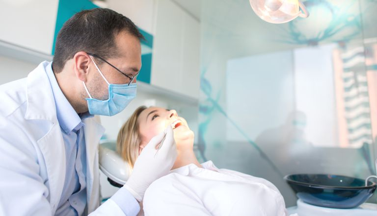 Dentist examining a patient